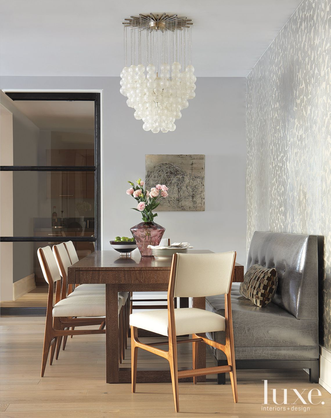 Modern Dining Area with Vintage Bubble Chandelier