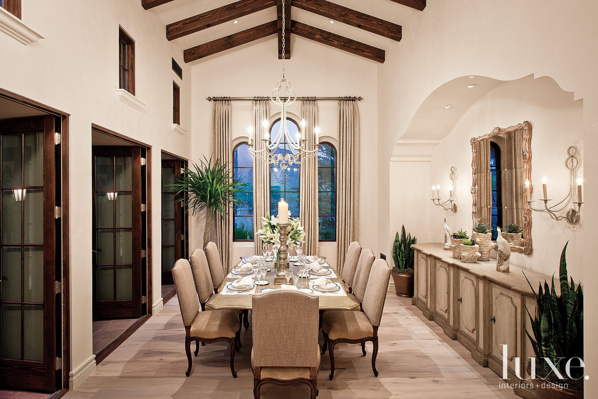 Traditional Neutral Dining Room with Carved Wood Sideboard