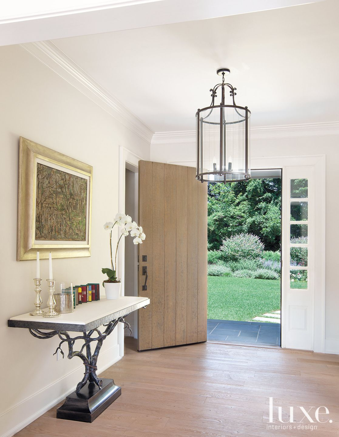 Traditional White Foyer with Sculptural Console