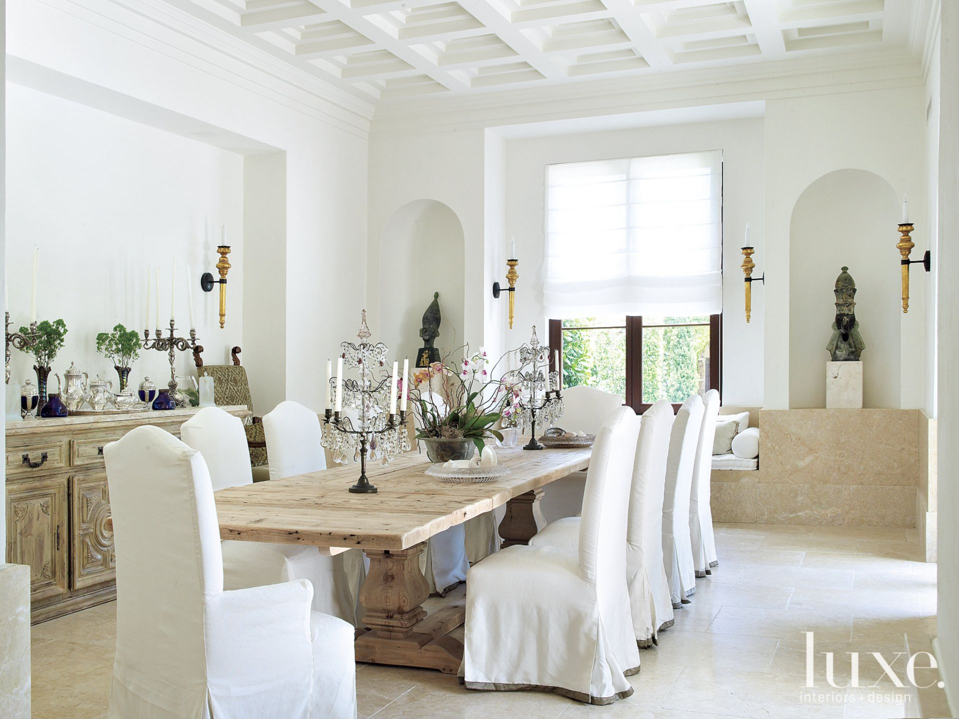 Mediterranean White Dining Room with Coffered Ceiling