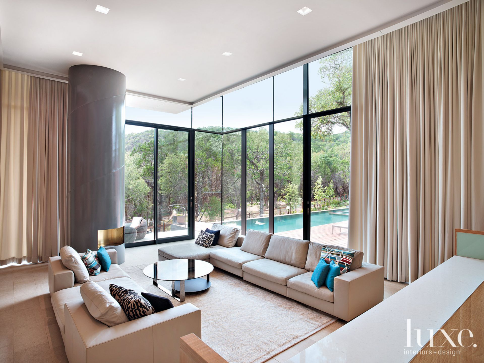 Neutral Contemporary Living Room with View of Pool