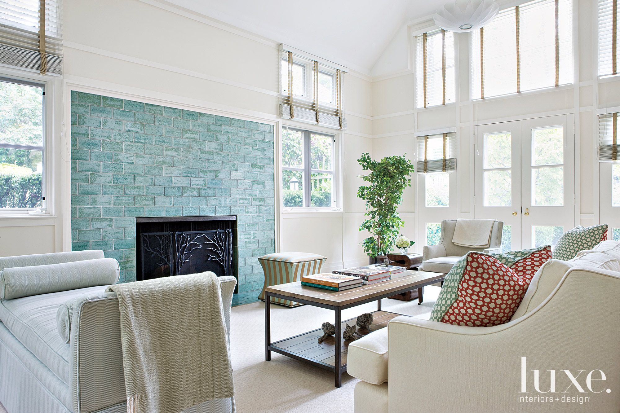 White and Cream Transitional Family Room with Blue Fireplace