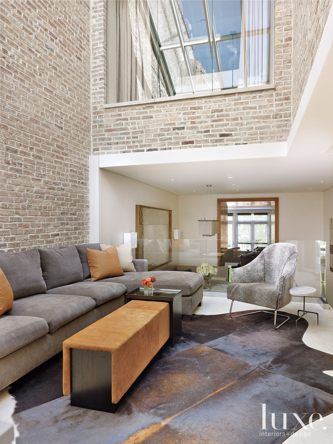 Contemporary Neutral Family Room with Tall Brick Walls