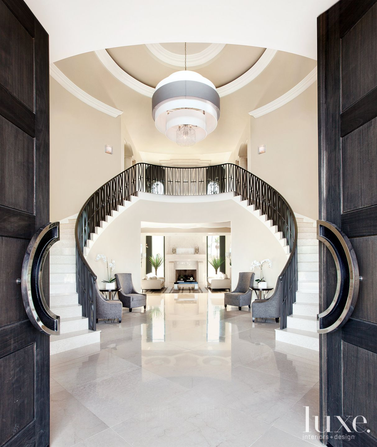 Contemporary White Entry with Double Staircase
