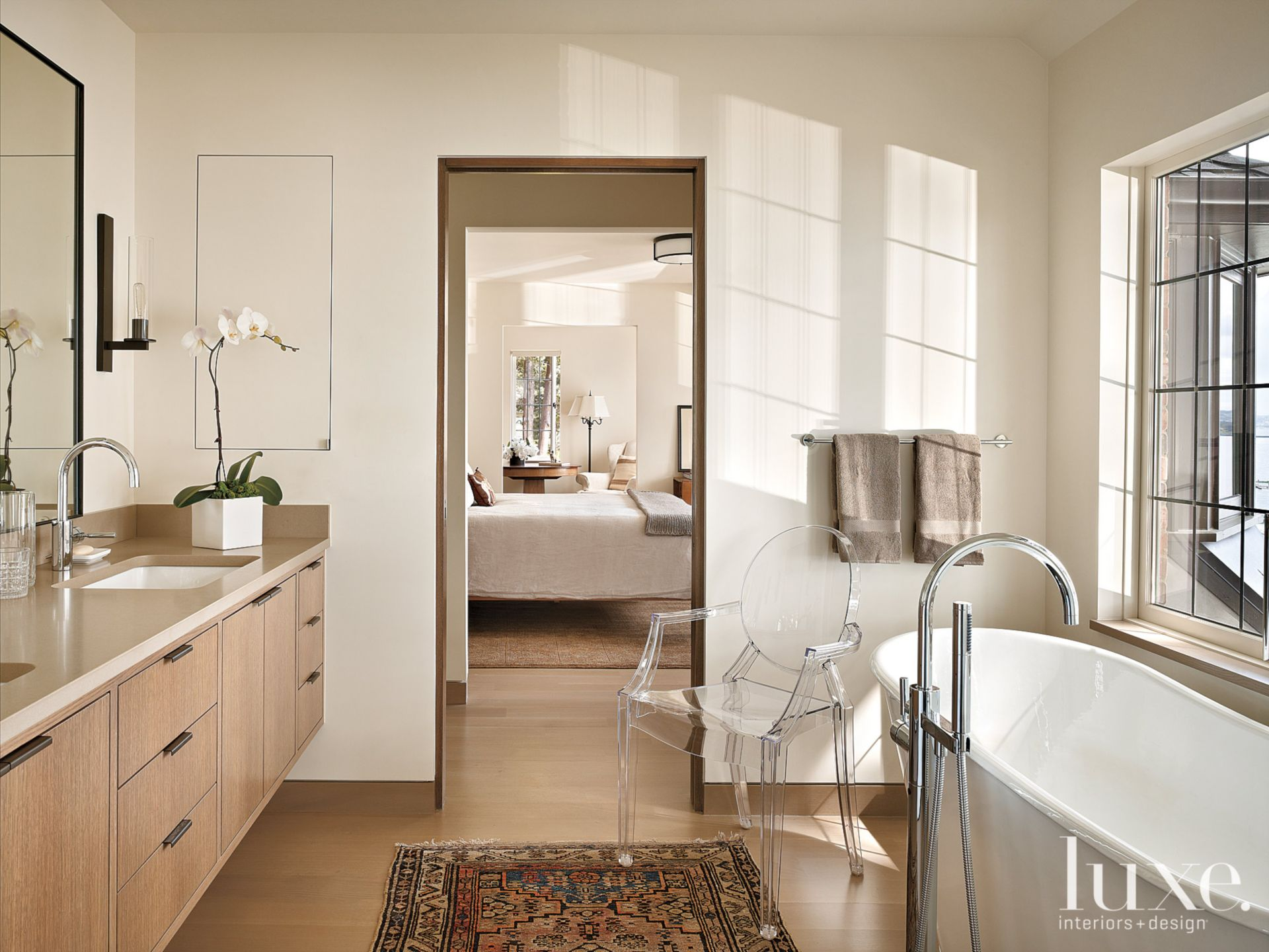 Contemporary White Master Bath with Modern Chair