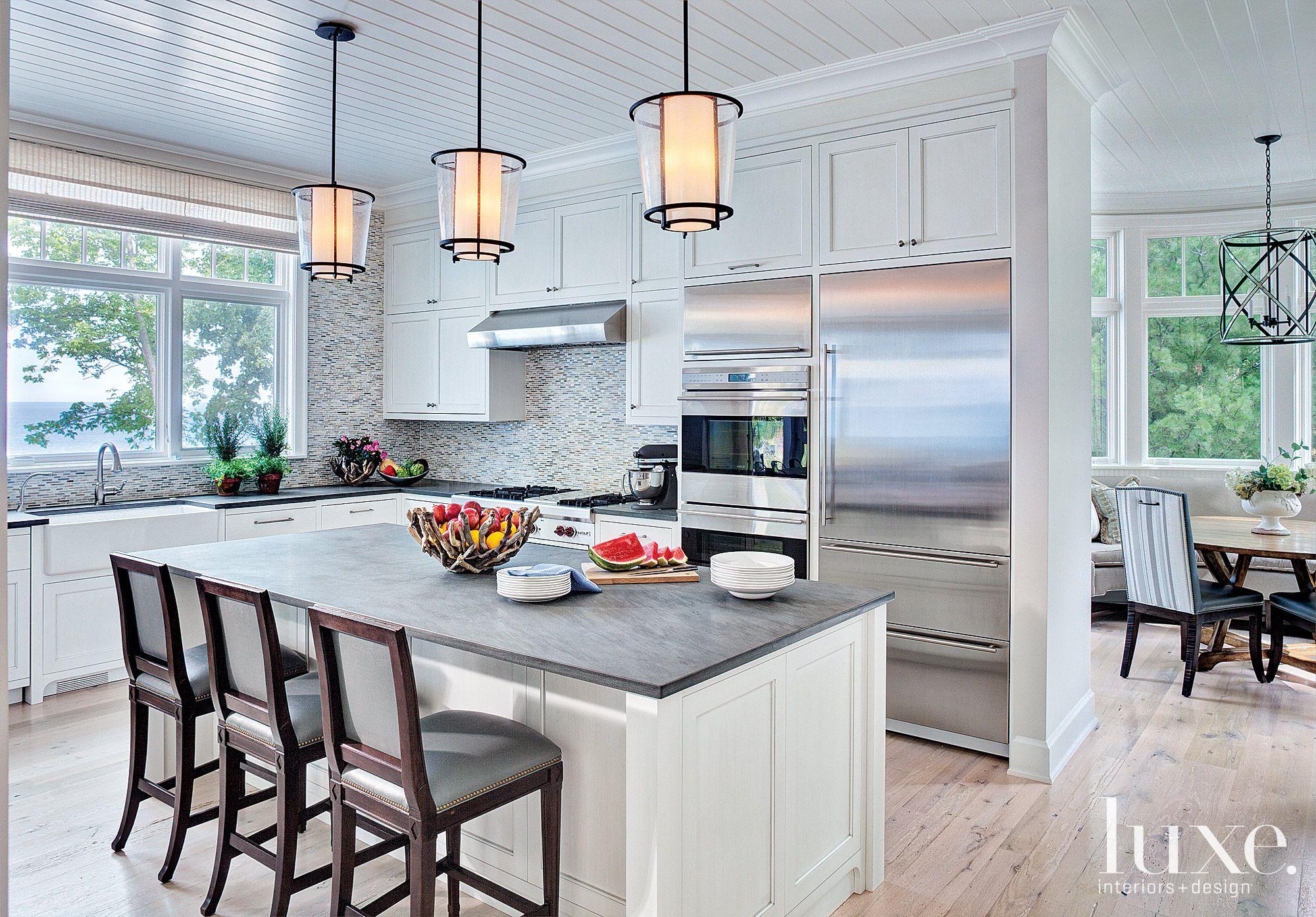 Contemporary White Kitchen with Mosaic Backsplash