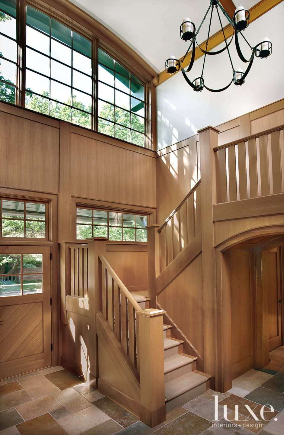 Traditional Brown Staircase with Light-Filled Atrium