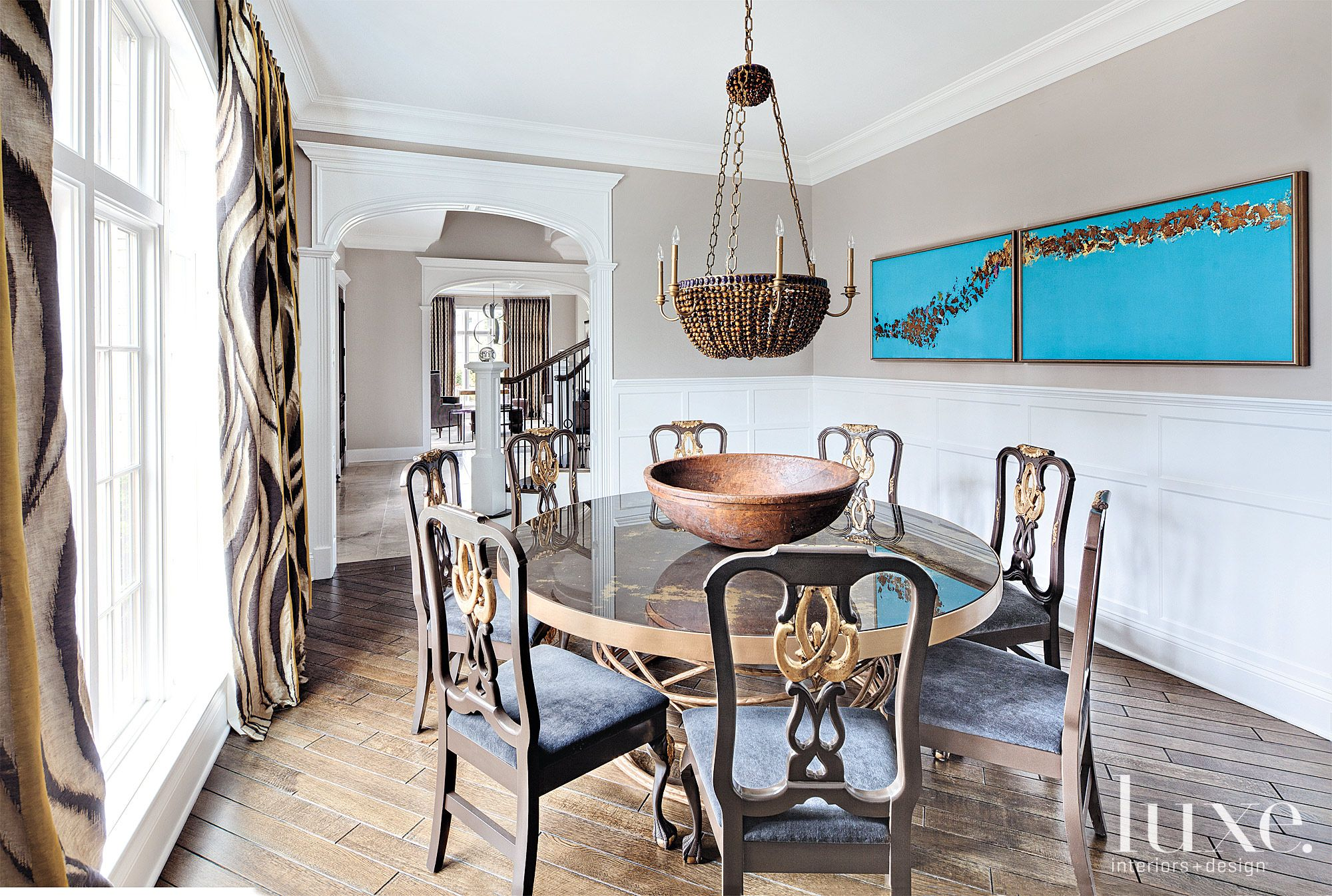 Contemporary Beige Dining Room with Blue Artwork