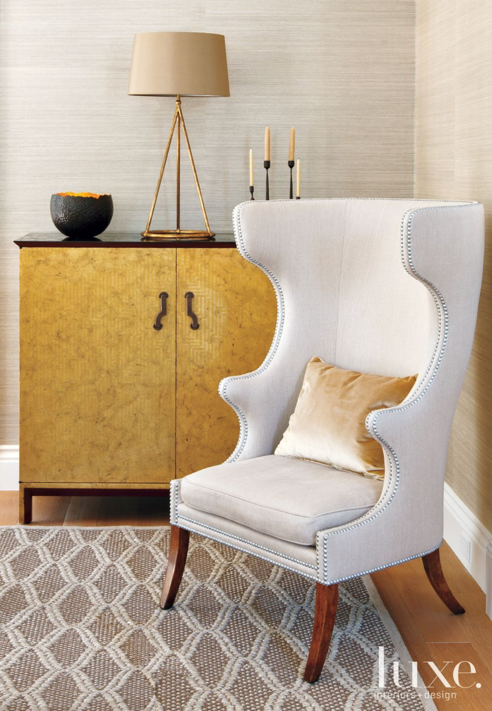 Transitional Cream Sitting Area with Wing Chair