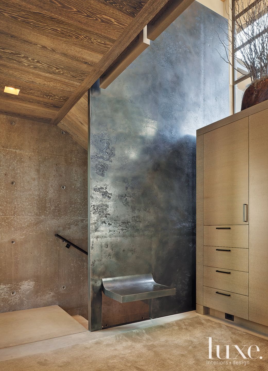 Contemporary Neutral Mudroom with Steel Wall