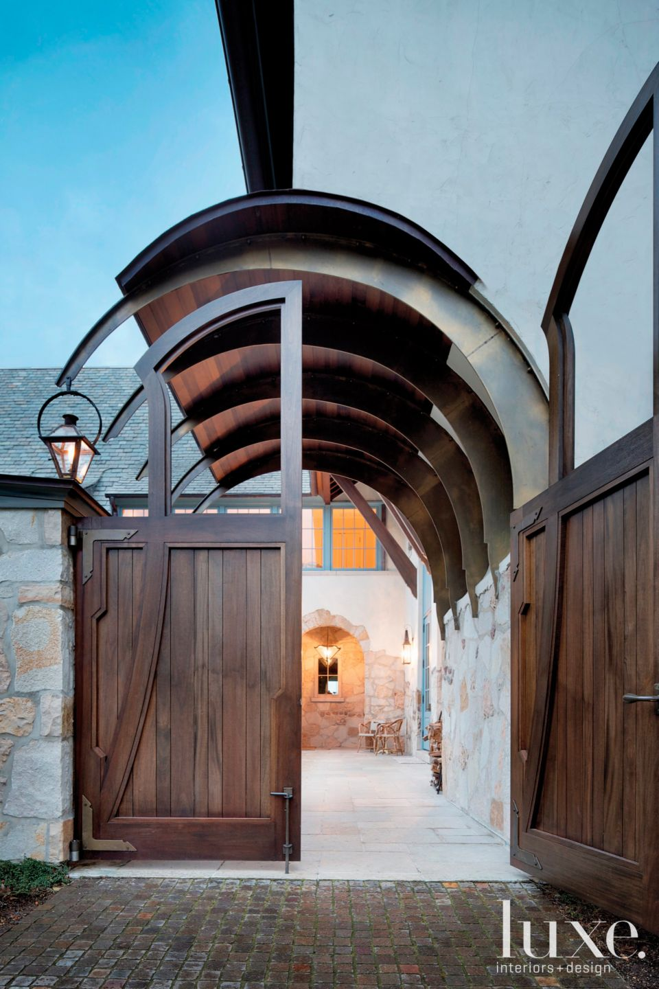Contemporary Neutral Arched Doorway with Gas Lanterns