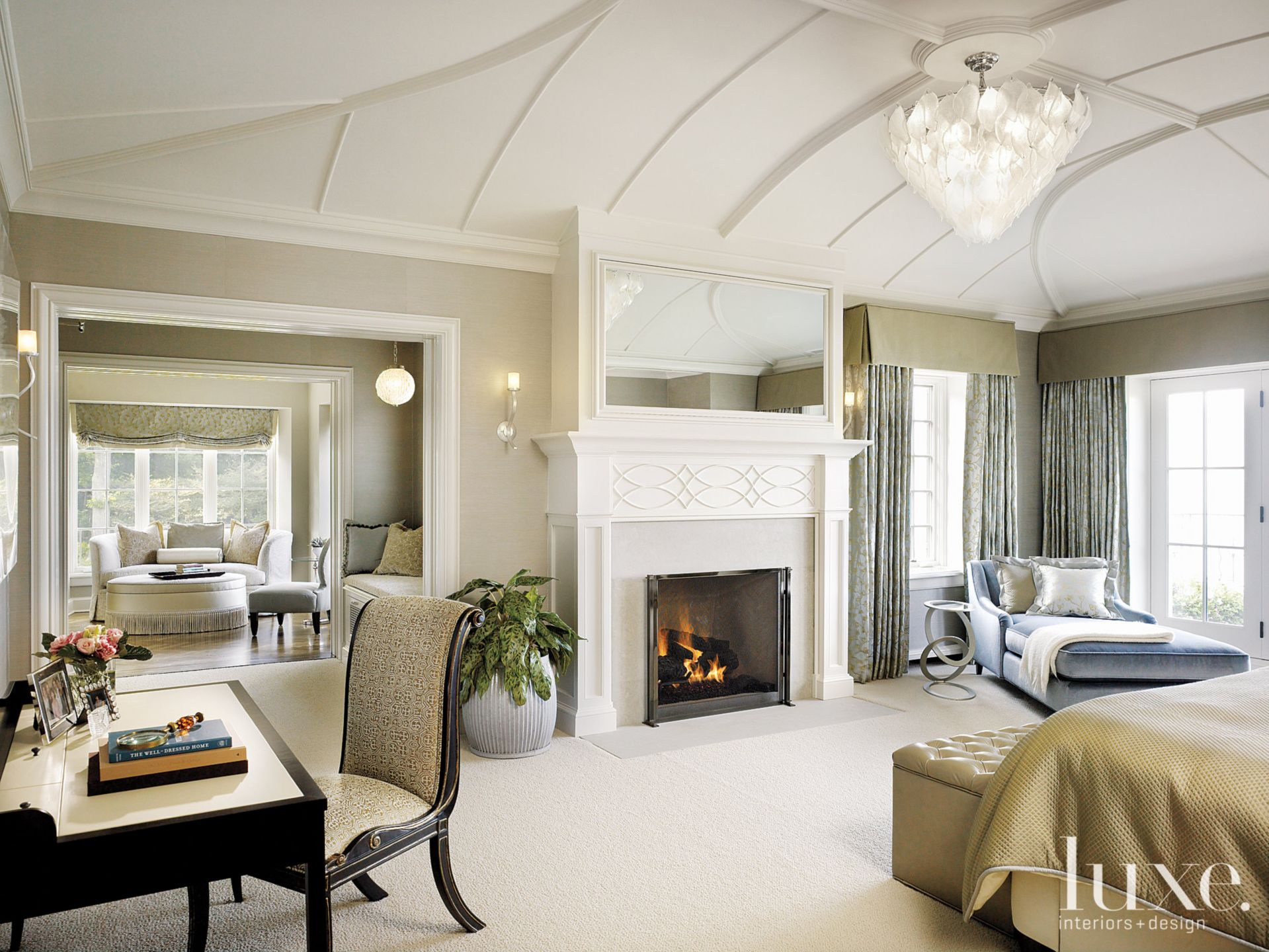 Contemporary Cream Bedroom with Vaulted Ceiling