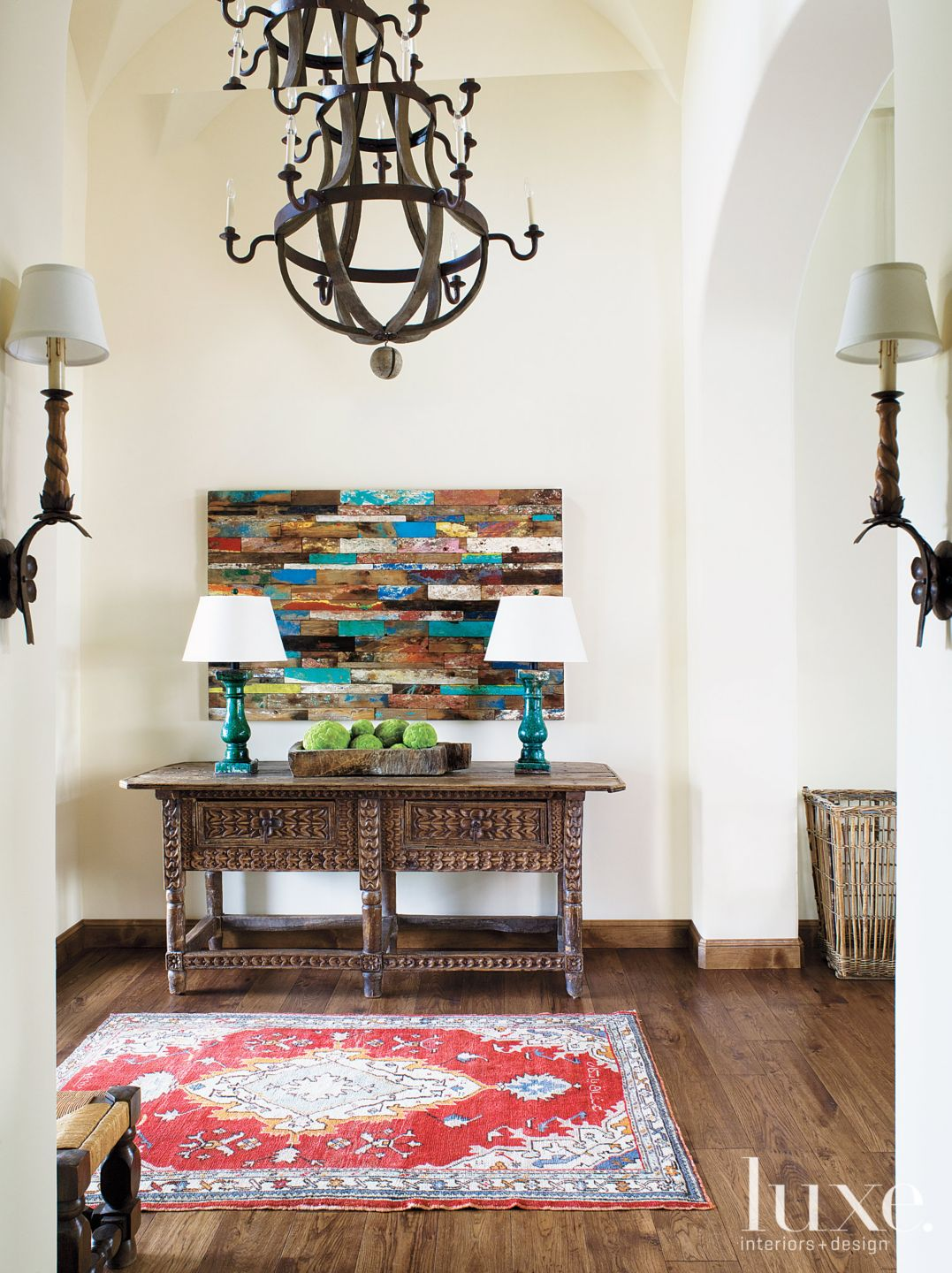 Eclectic White Foyer with Spanish-Style Sideboard