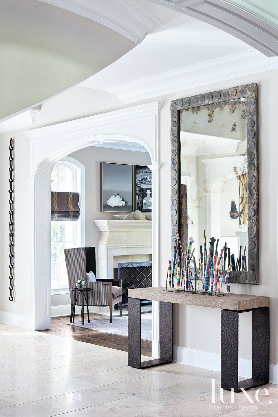 Contemporary Neutral Foyer with Industrial Mirror
