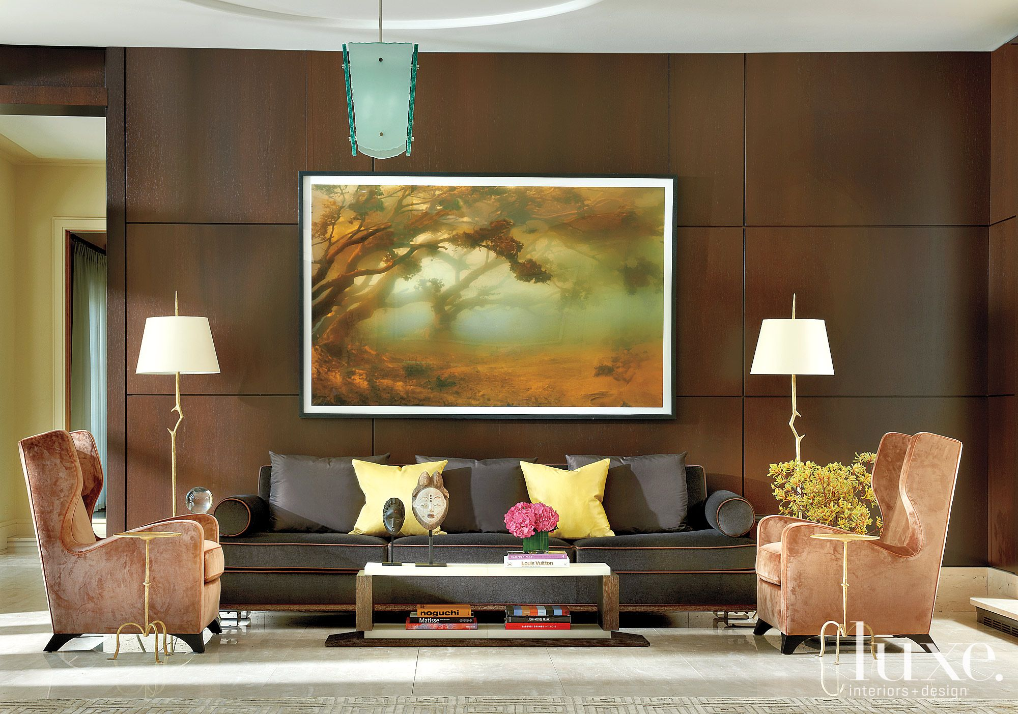 Transitional Brown Great Room with large forest painting