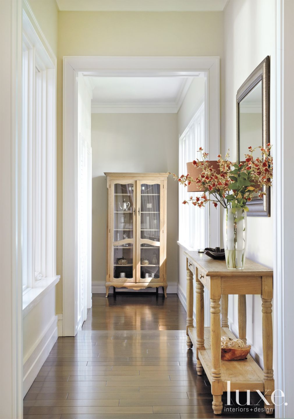Transitional Cream Hallway with Walnut Flooring