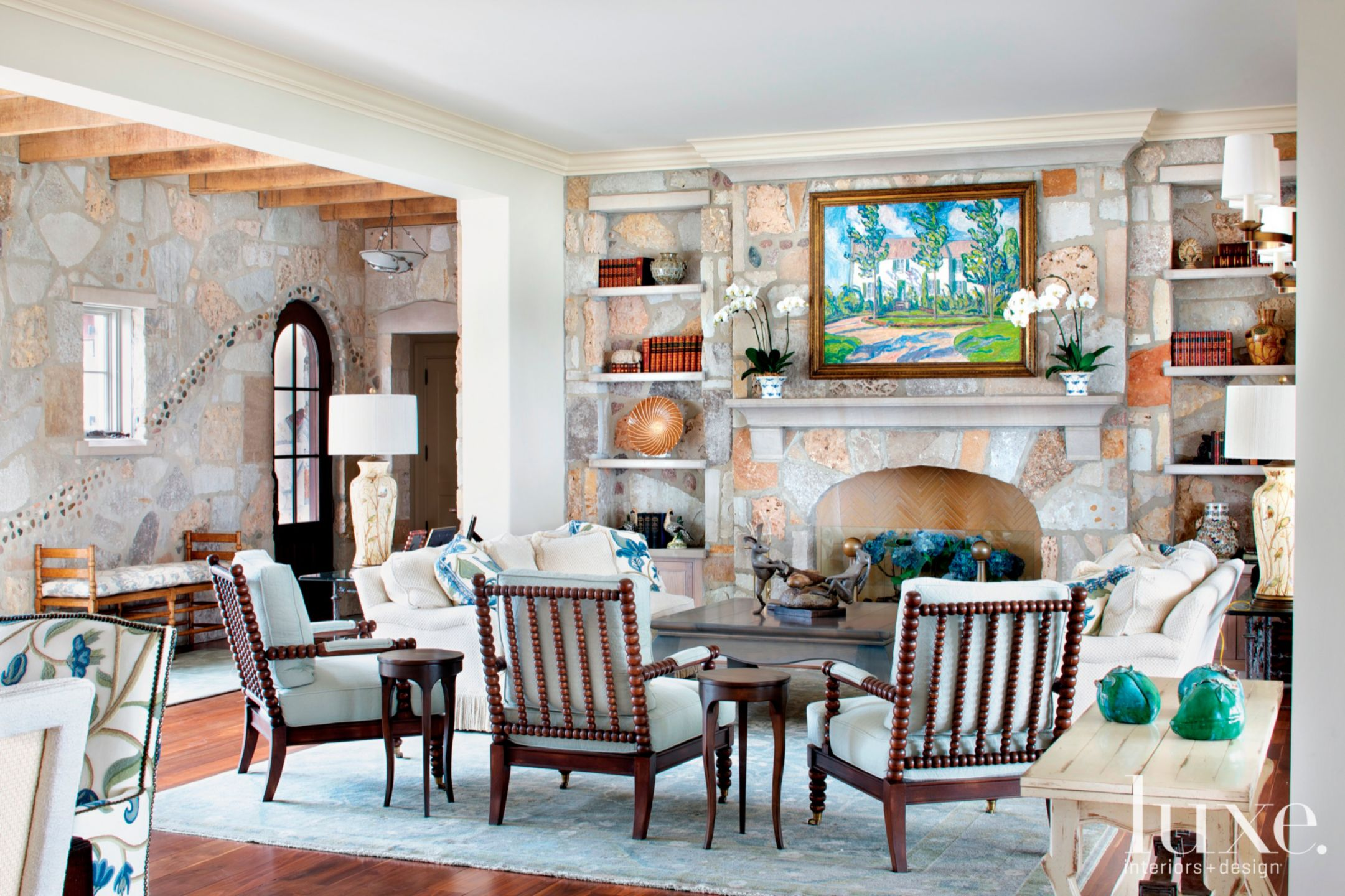 Contemporary Neutral Living Room with Reclaimed Wood and Exposed Stone Fireplace