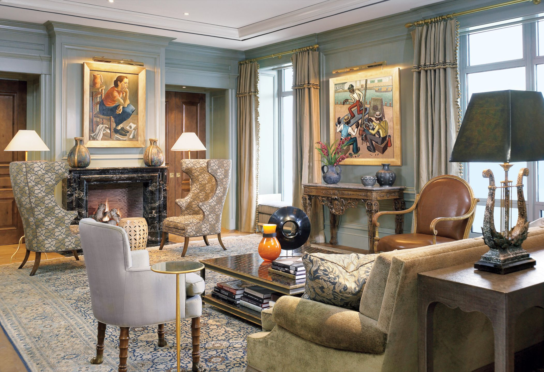 Traditional Blue Living Room with French Artwork