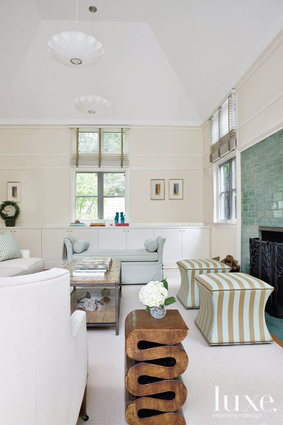 Transitional Cream Family Room with Striped Ottomans