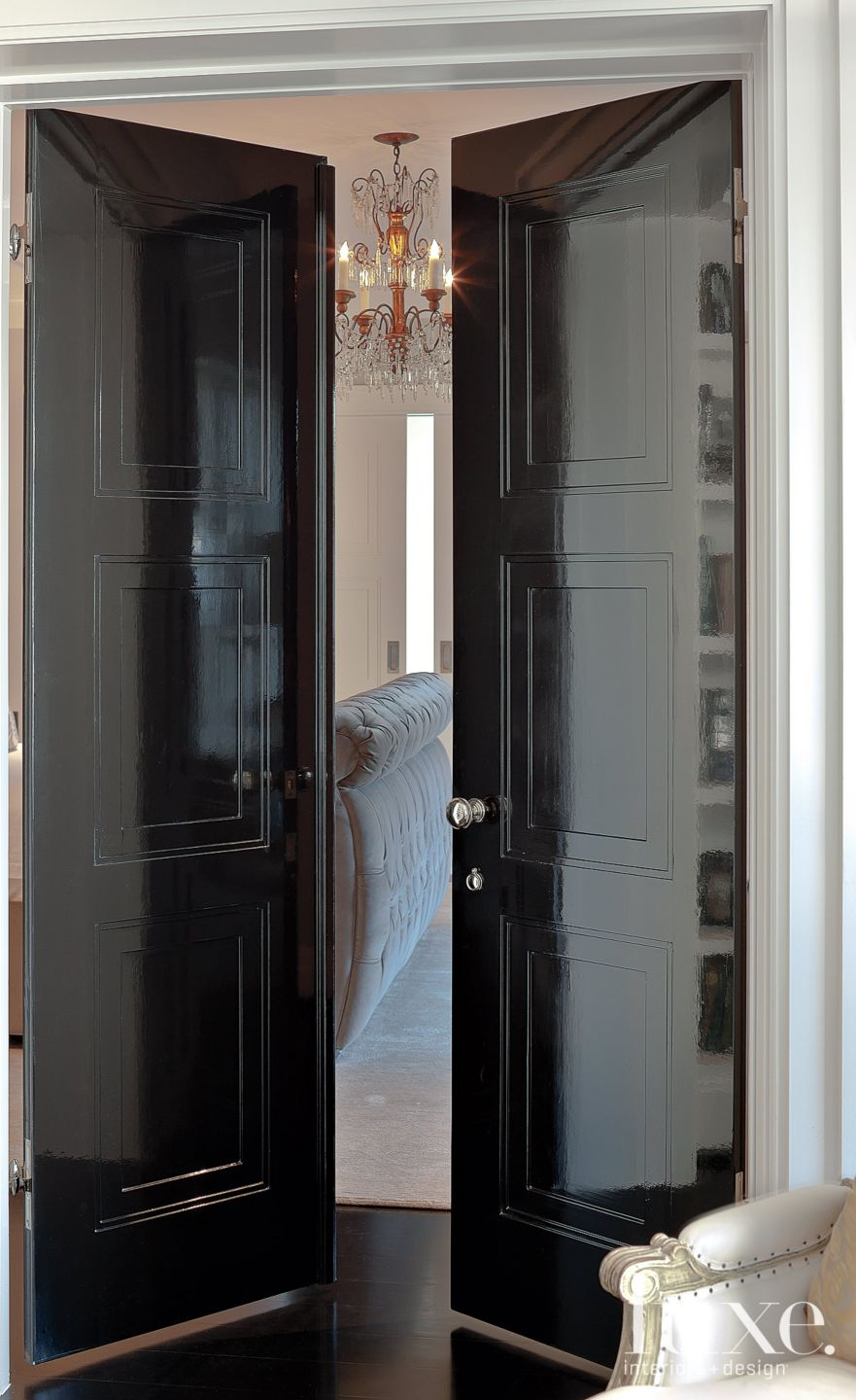 Glossy Black Doors into Master Bedroom
