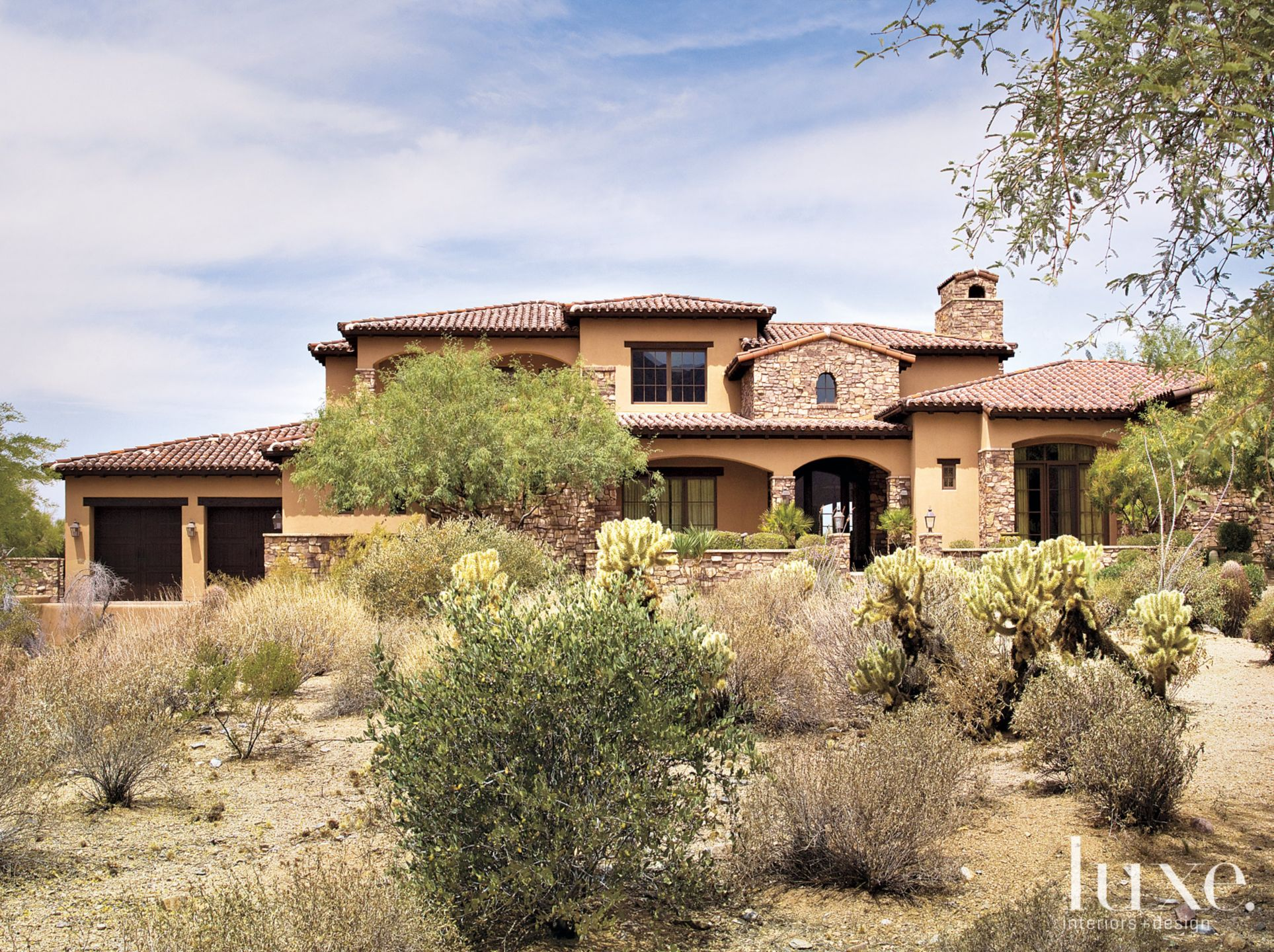 Traditional Neutral Ranch with Stucco and Stacked-Stone Exterior