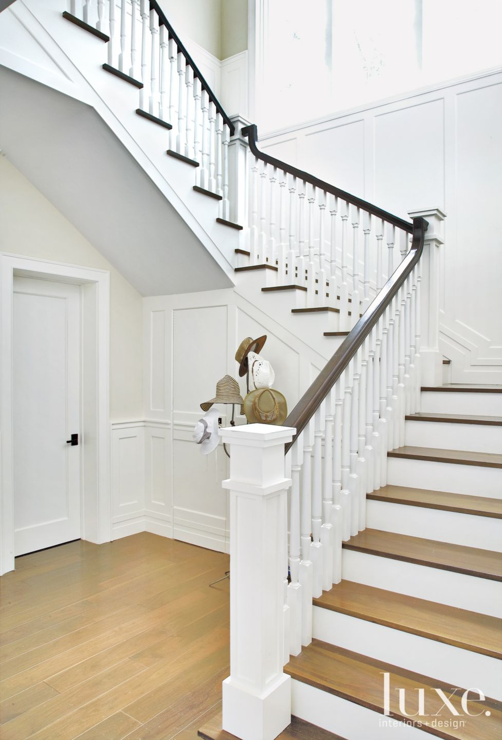 Transitional White Staircase with Dark Wood Banister