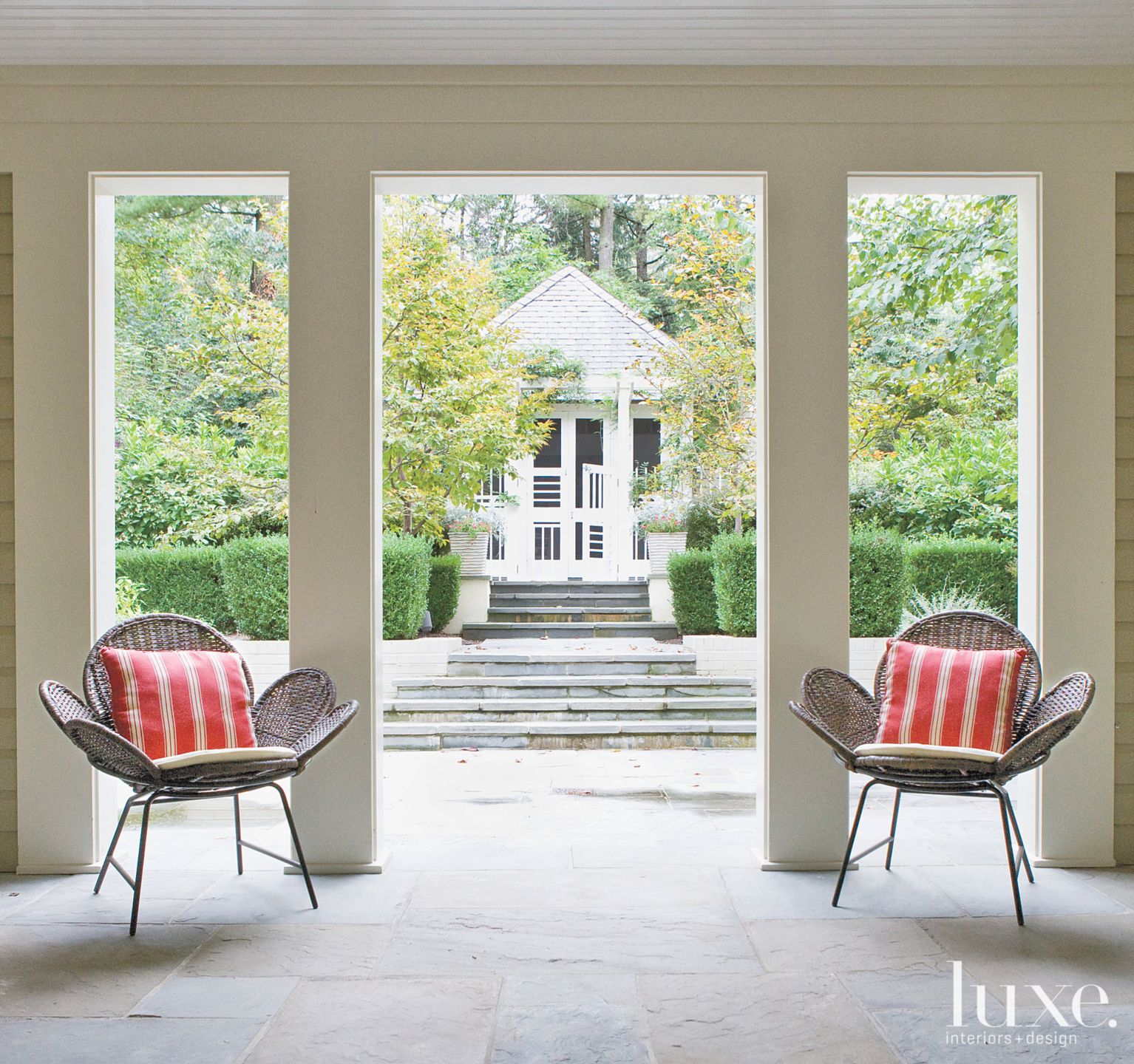 Transitional Neutral Patio with Wicker Chairs