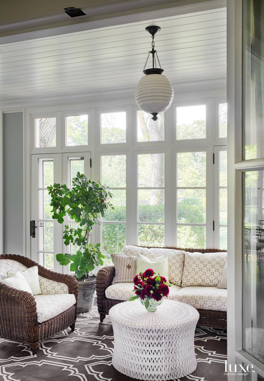 Traditional White Porch with Wicker Sofa and Chair