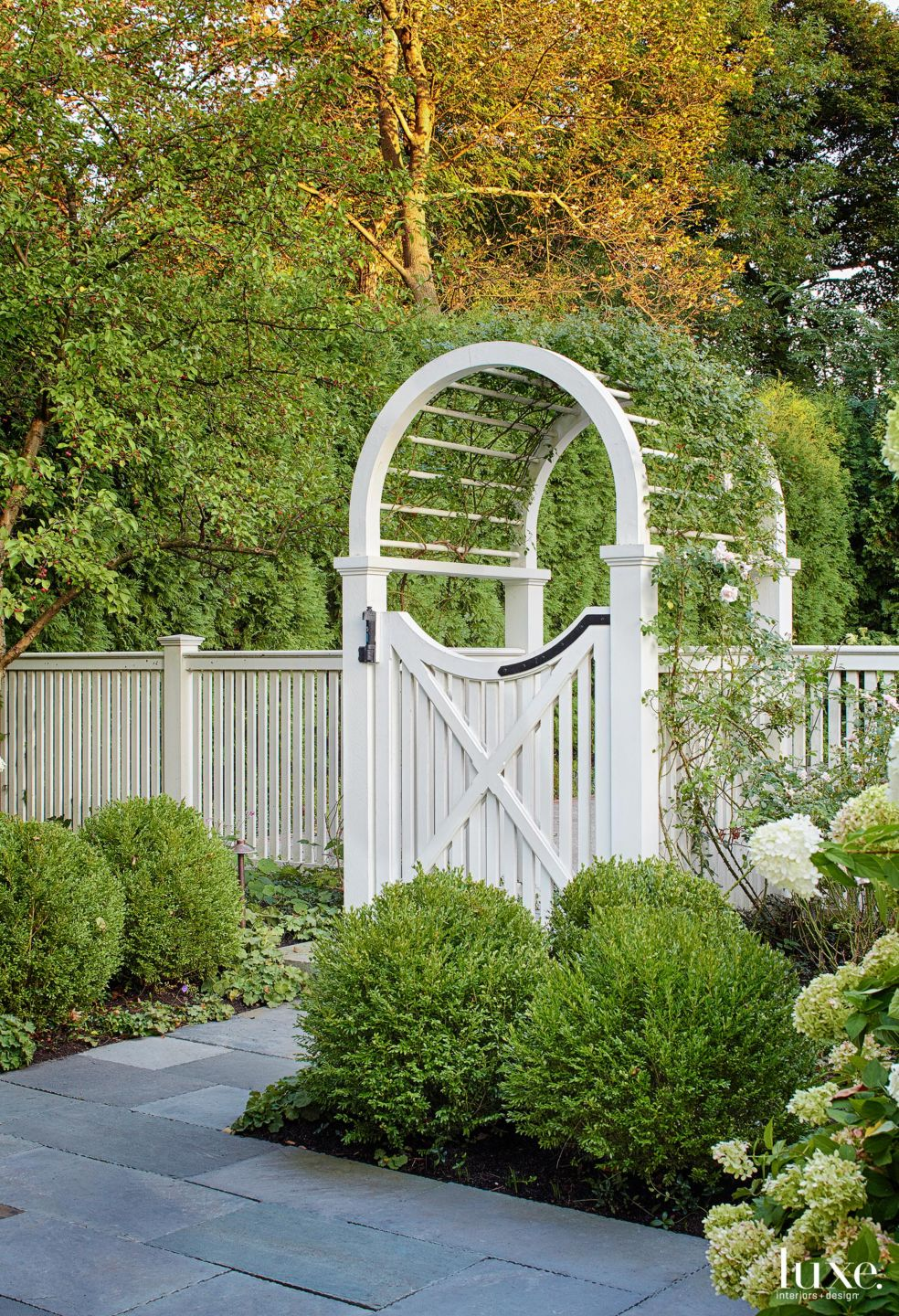 Traditional White Outdoor Space with Wooden Arbor