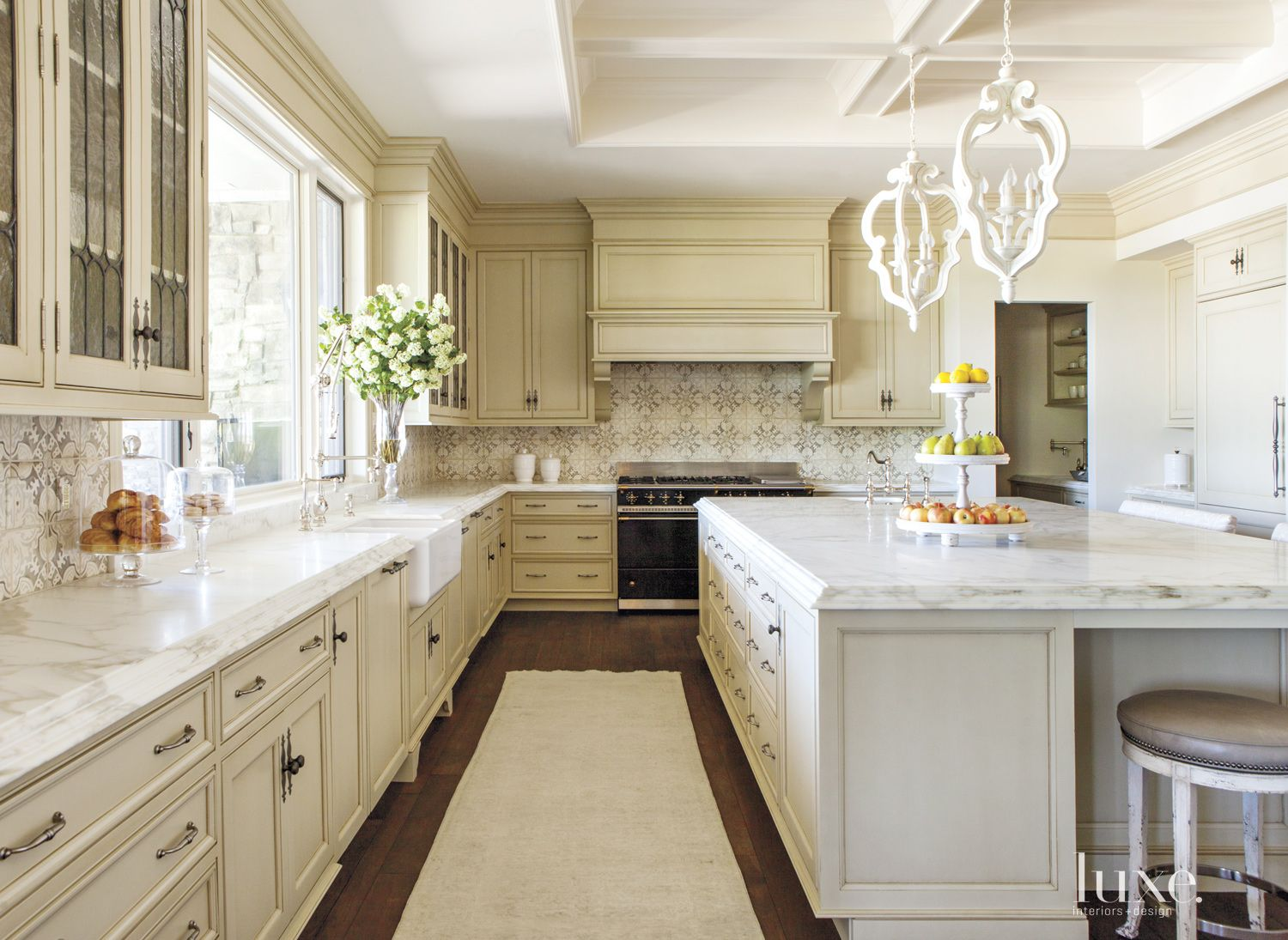 Traditional White Kitchen with Sculptural Pendants