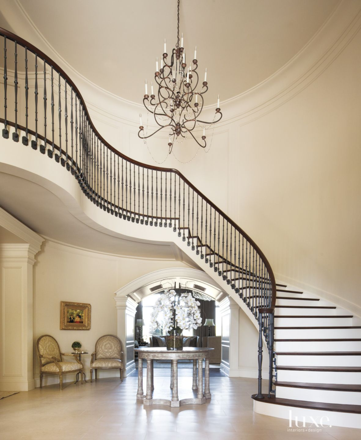 Traditional White Staircase with Iron Railing