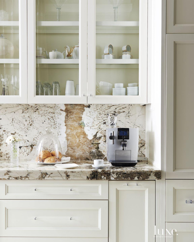 Mediterranean Neutral Kitchen Detail with Granite Backsplash