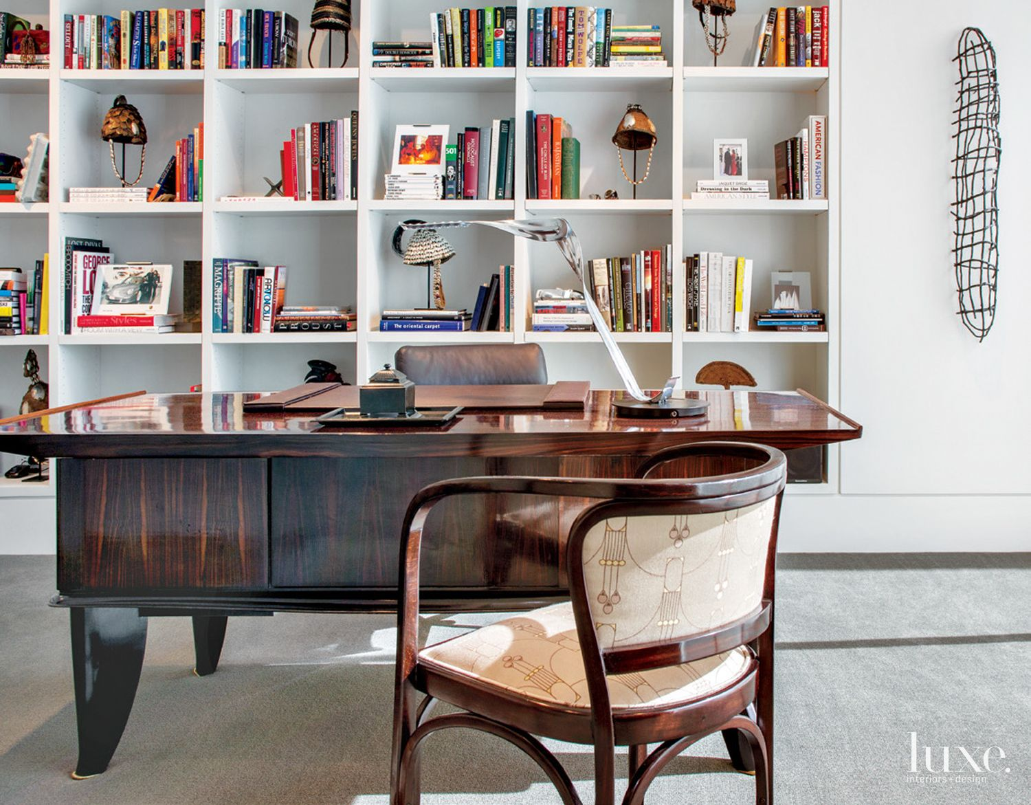 Contemporary White Library with Art Deco Desk