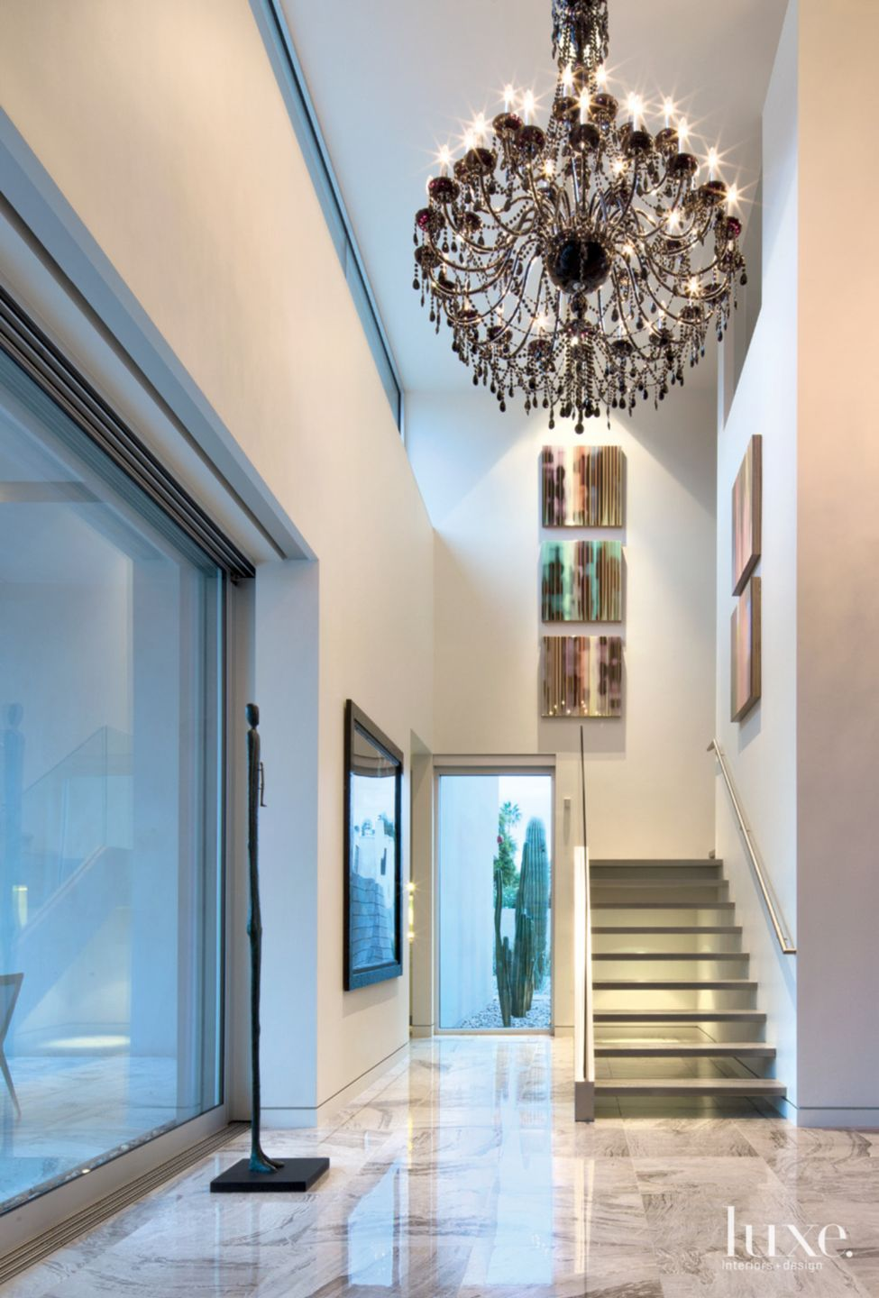 Modern White Hall with Crystal Chandelier