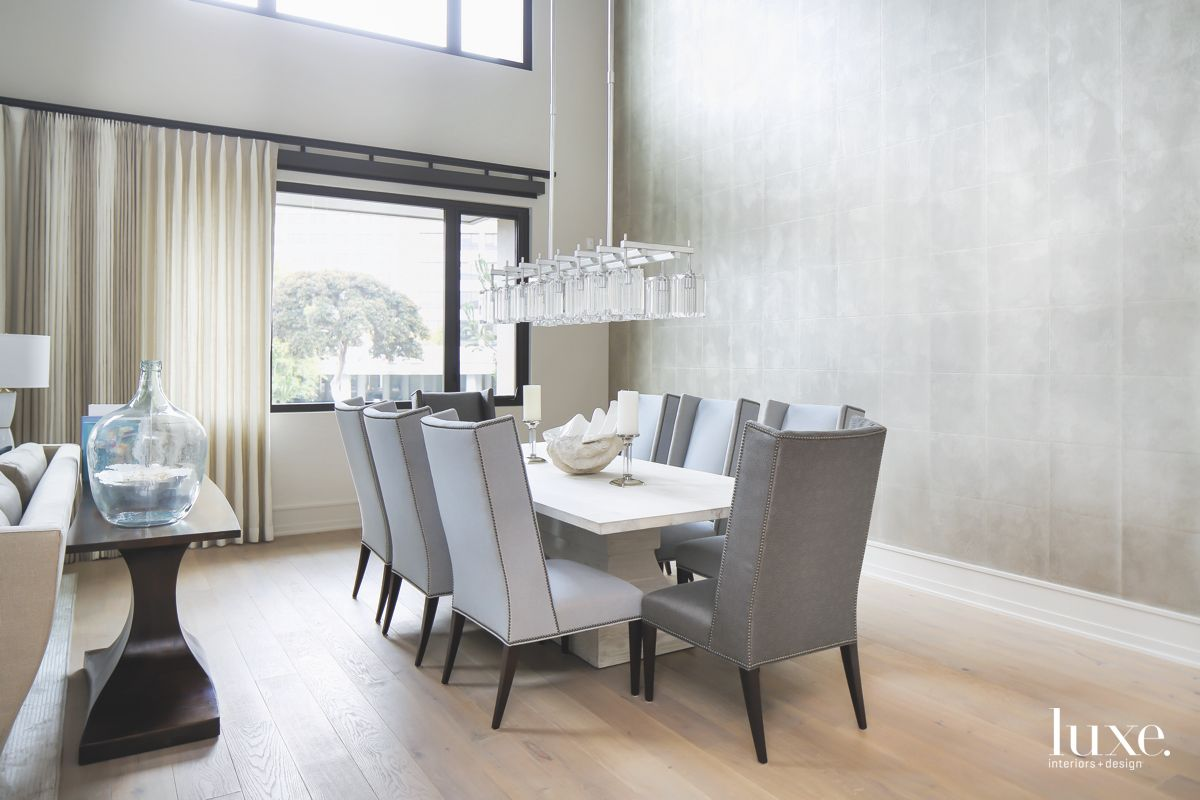 All Gray Dining Room with Statement Chandelier and Large Window