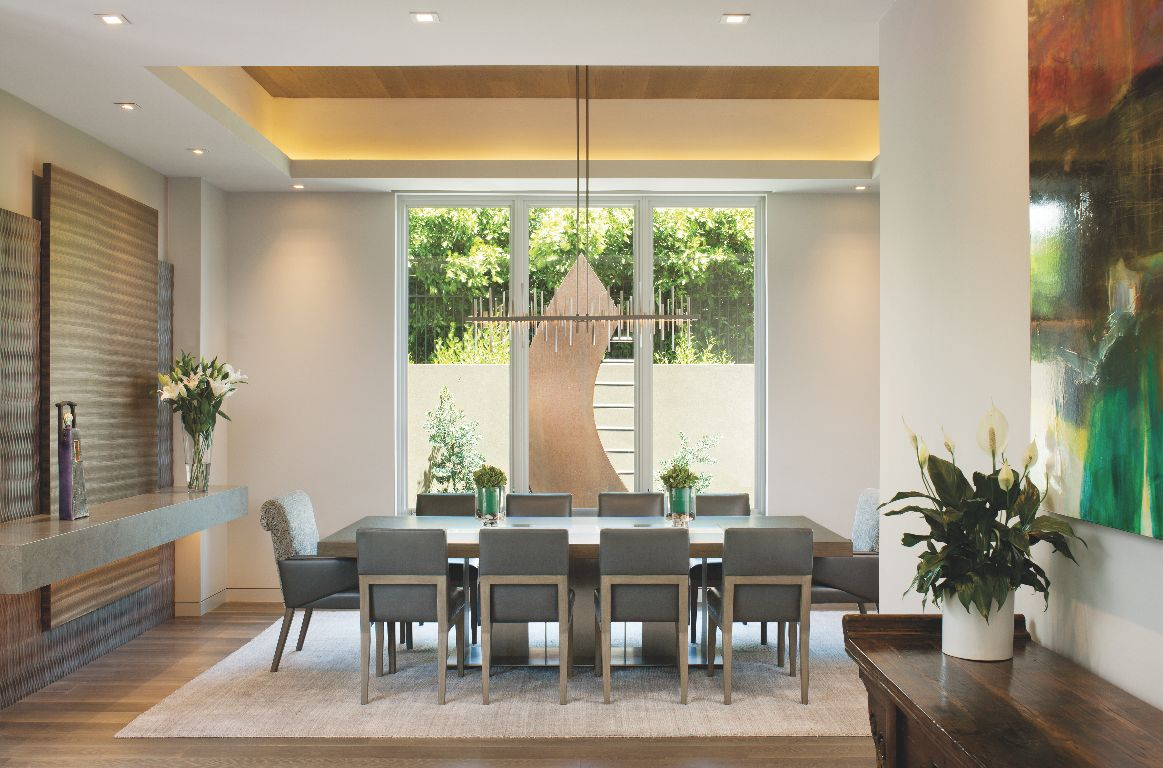 Contemporary Seating Dining Room with Artwork View and Flowers