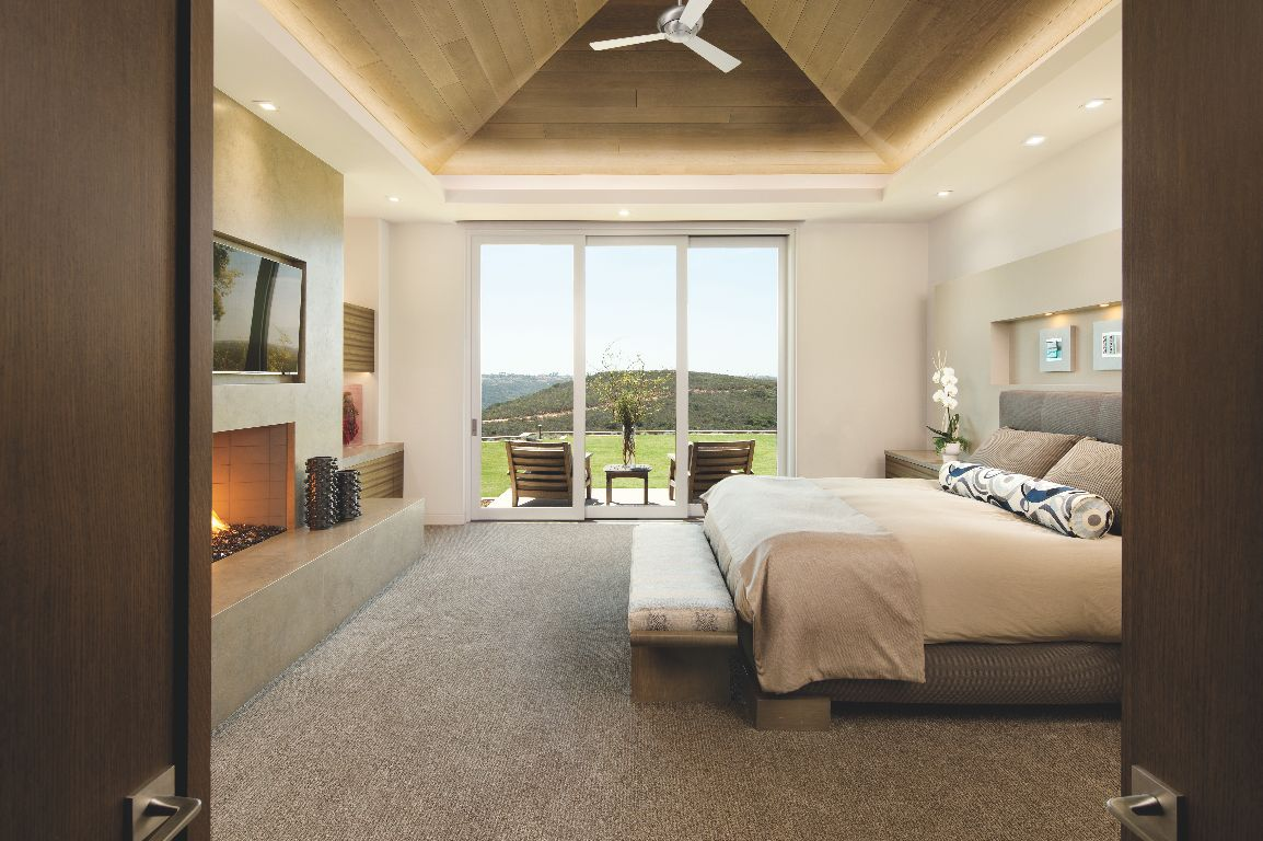 Backyard View Canyon Master Bedroom with Fireplace and Television with Art