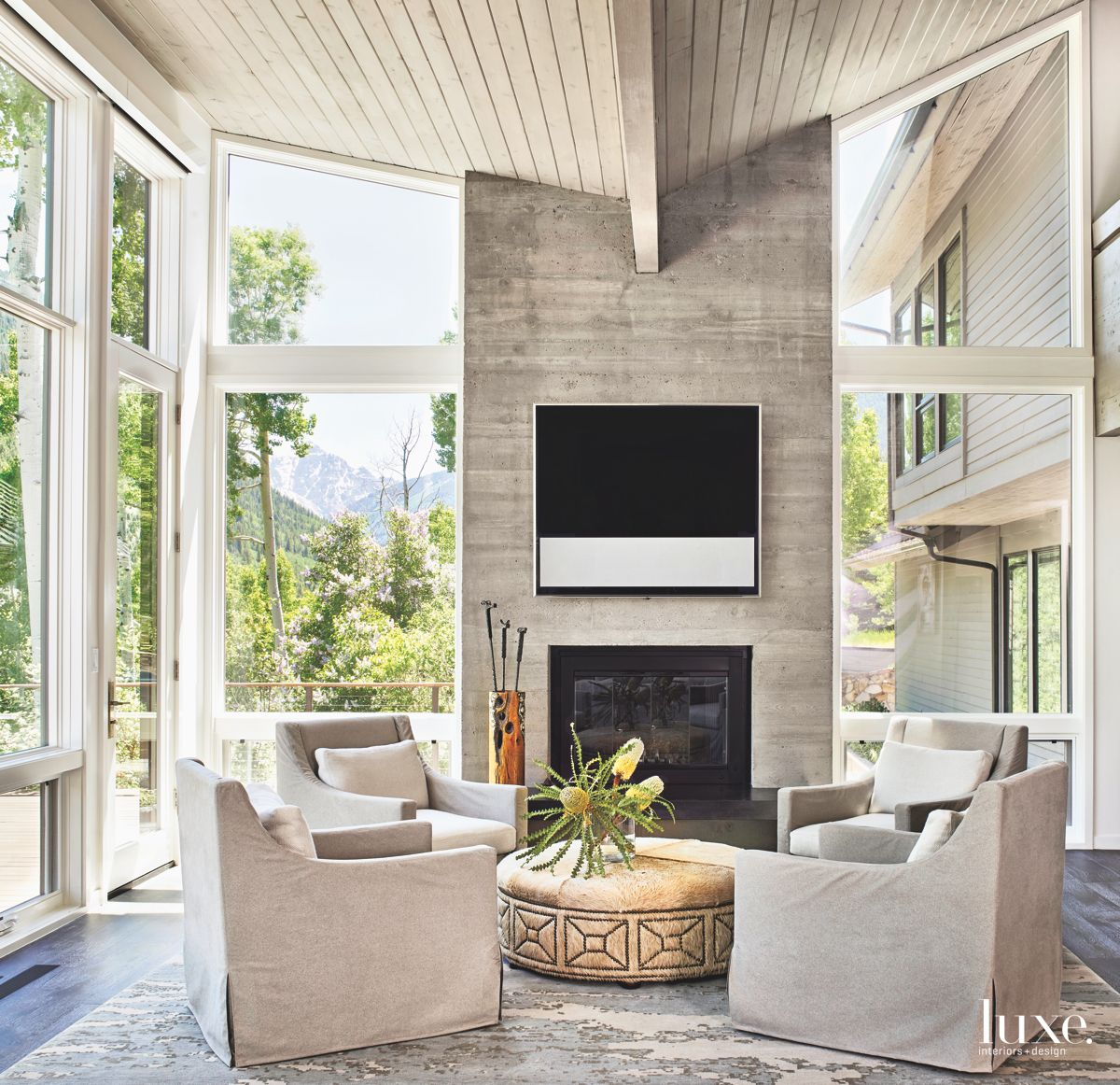 Concrete Fireplace with Mounted Television Living Room