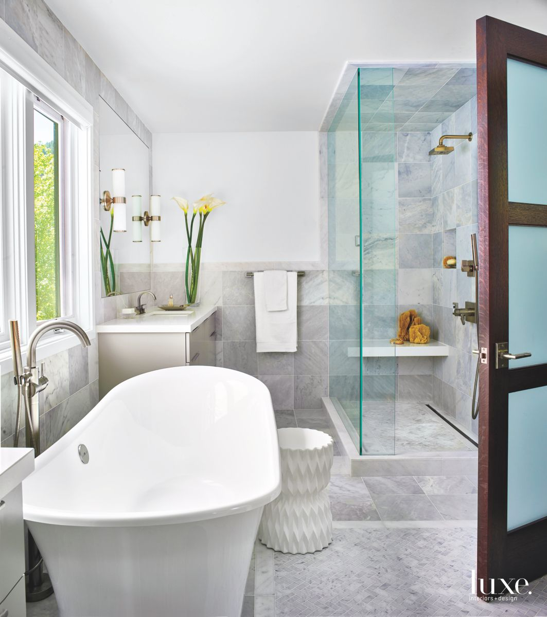 Large Soaking Tub Gray Master Bathroom with Flowers and Sconces