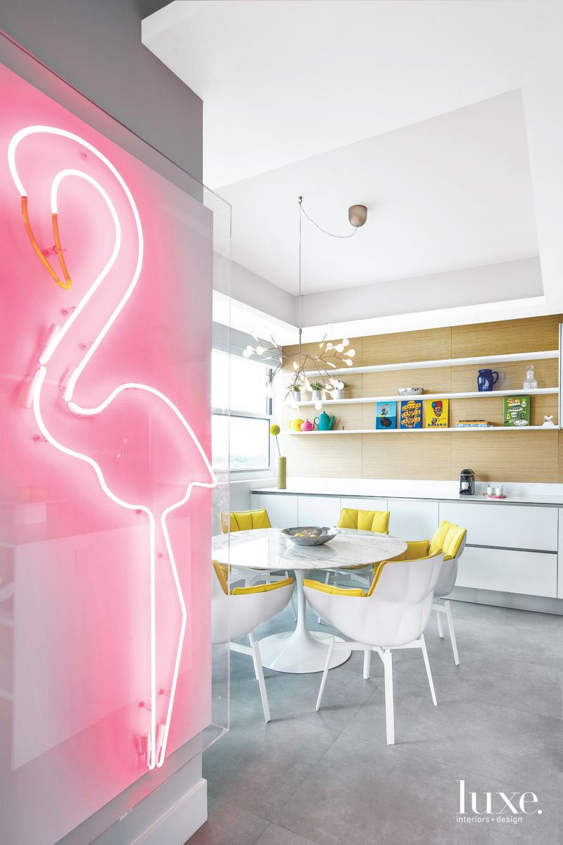 Neon Pink Flamingo Sign Dining Area