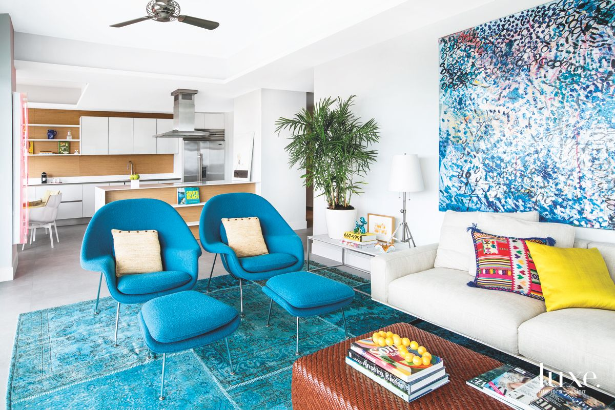 Blue Iconic Chairs Living Area with Kitchen View