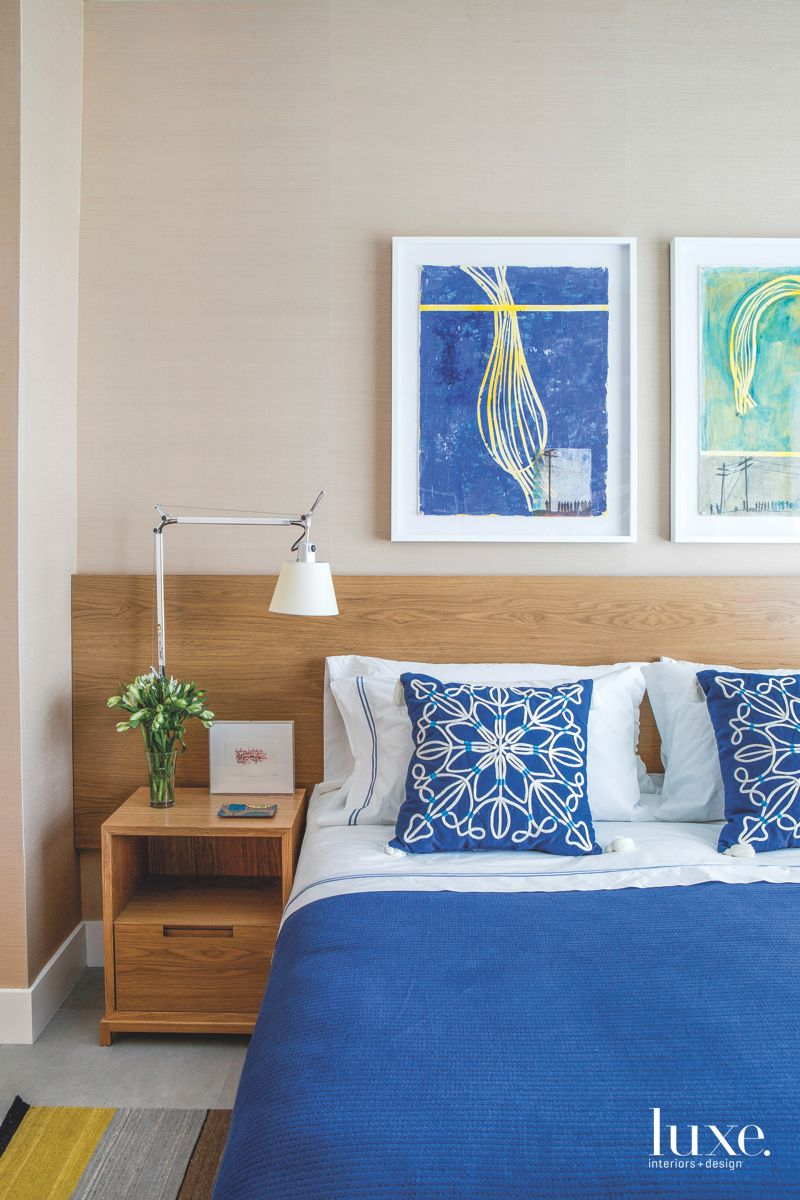Bed Closeup with Custom Wooden Headboard and Artwork