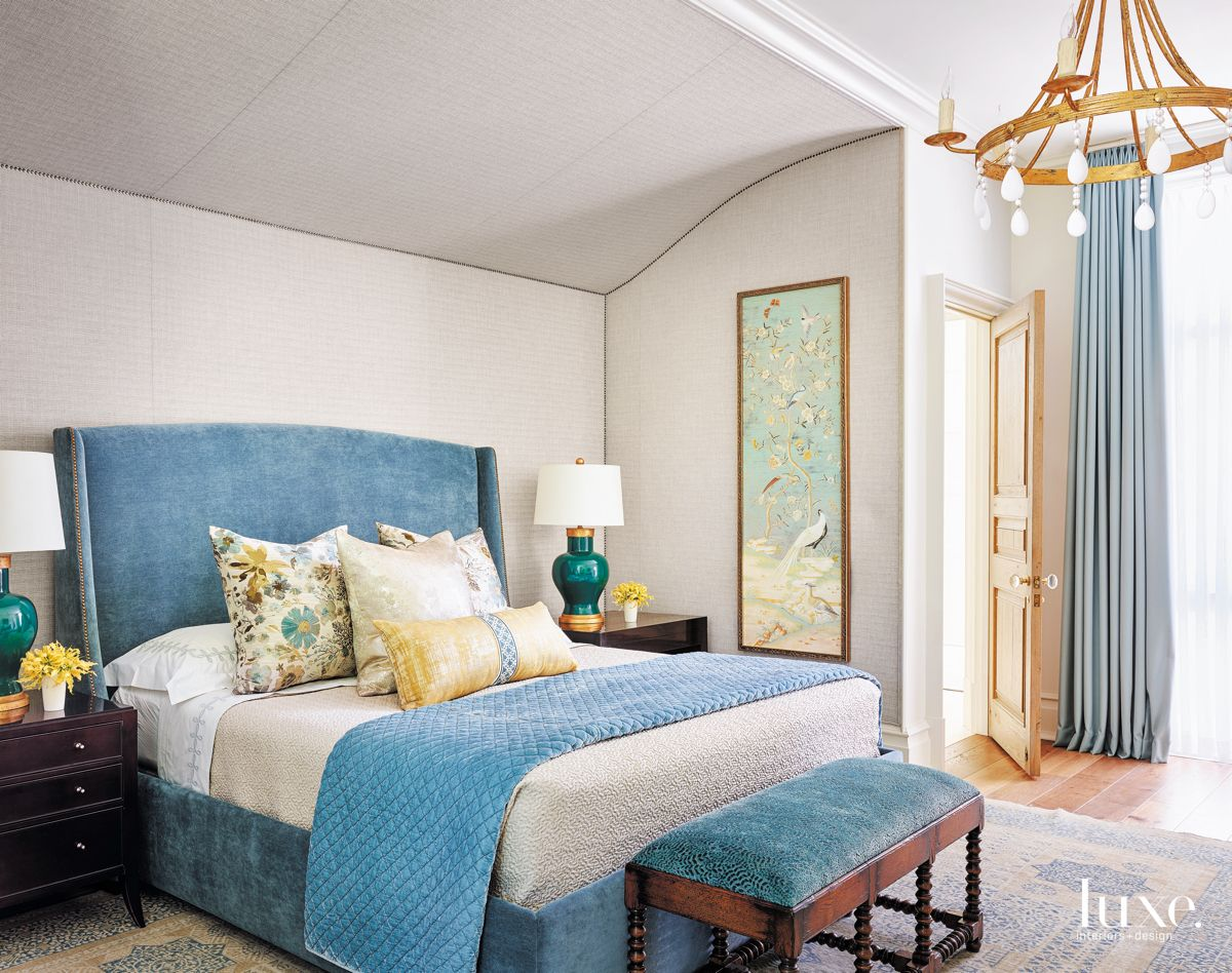 Serene Blue Master Bedroom with Art and Chandelier