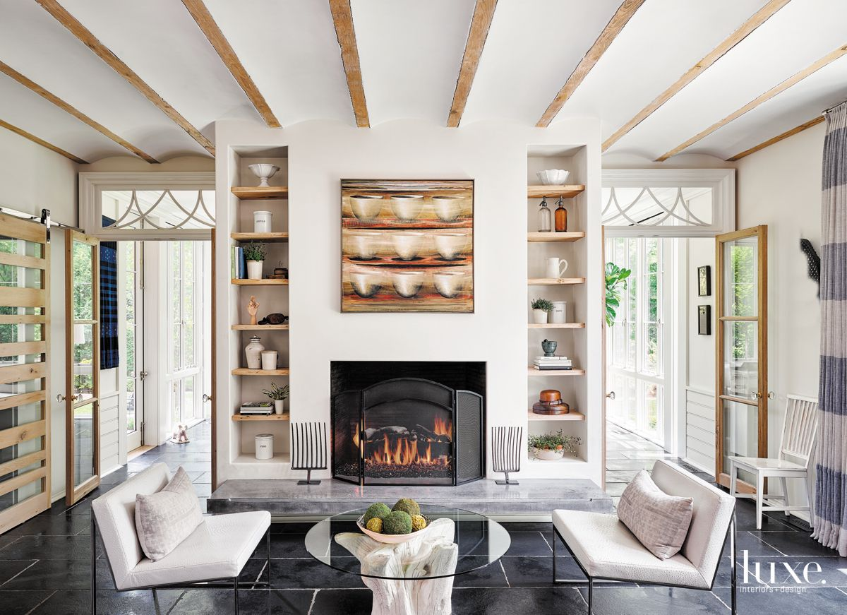 Seating Area with Lots of Shelving and a Fireplace