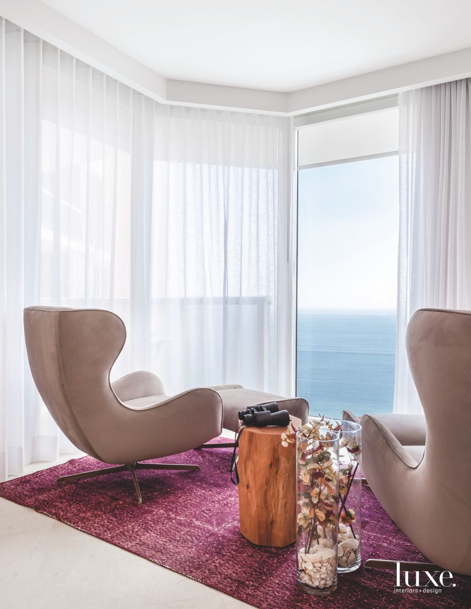 Reading Nook with Magenta Carpet, Wingback Chairs, and Ocean View