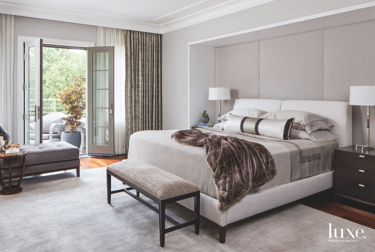 Master Bedroom with Gray Overtones, Cozy Fur Throw, Bench, and Lamp