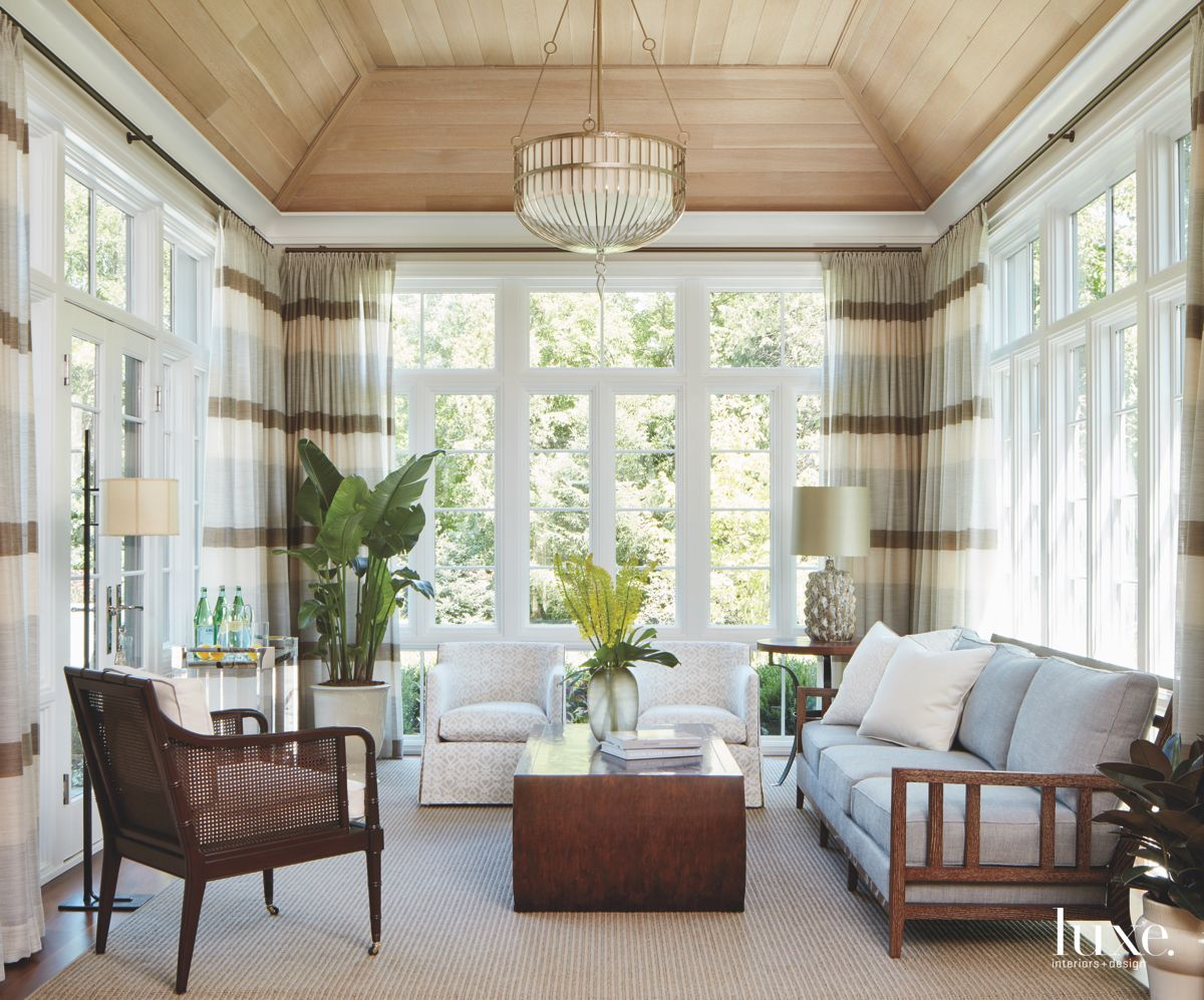 Bright and Airy Sunroom with Plants, Chandelier and Sofa