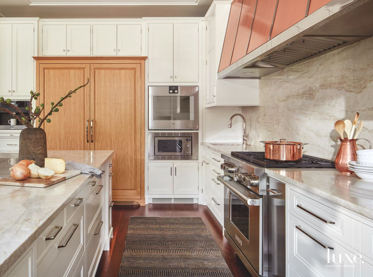 Copper Hinted Kitchen with Wooden Concealed Refrigerator