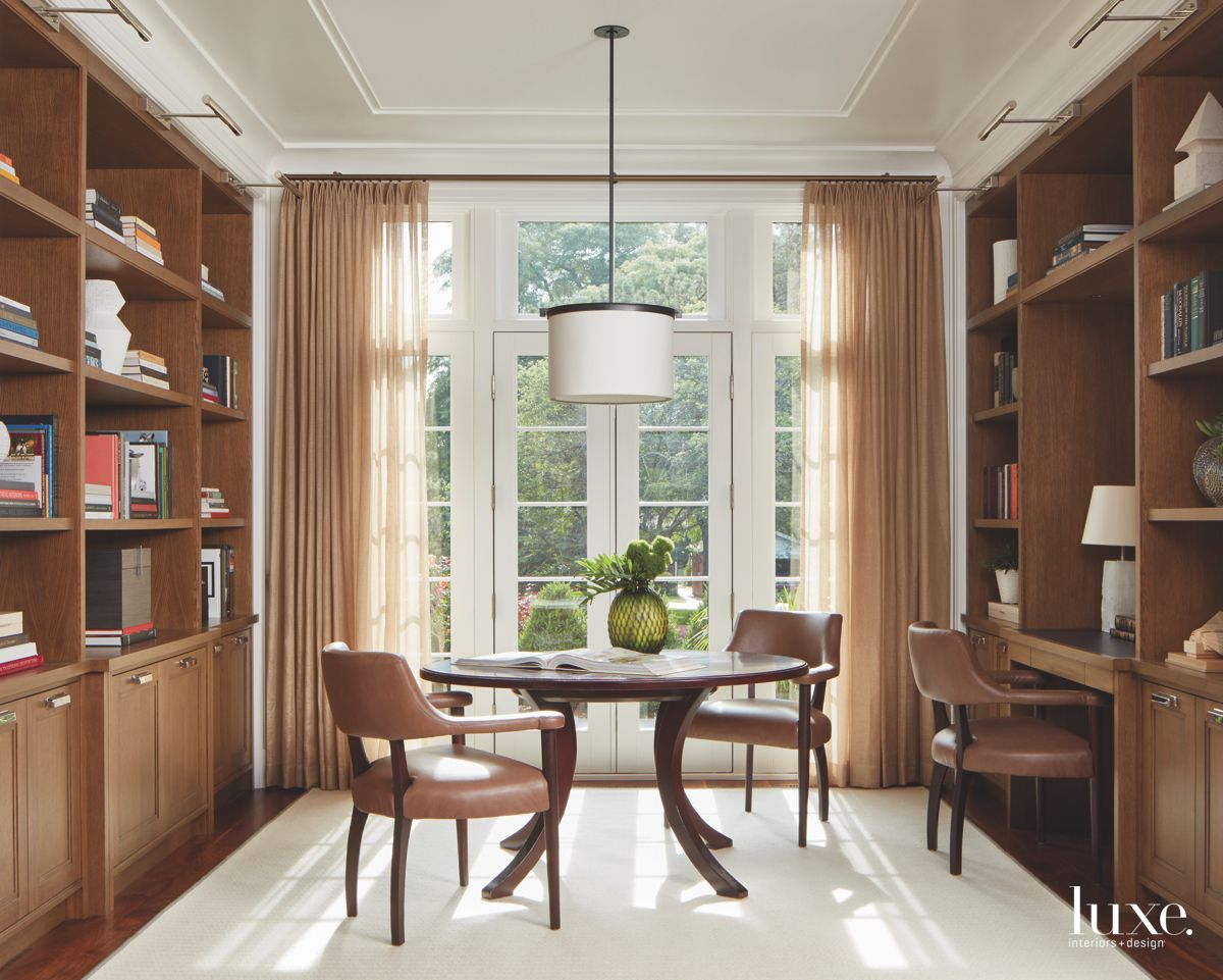 Neutral Library with Table and Chairs and Glass Doors