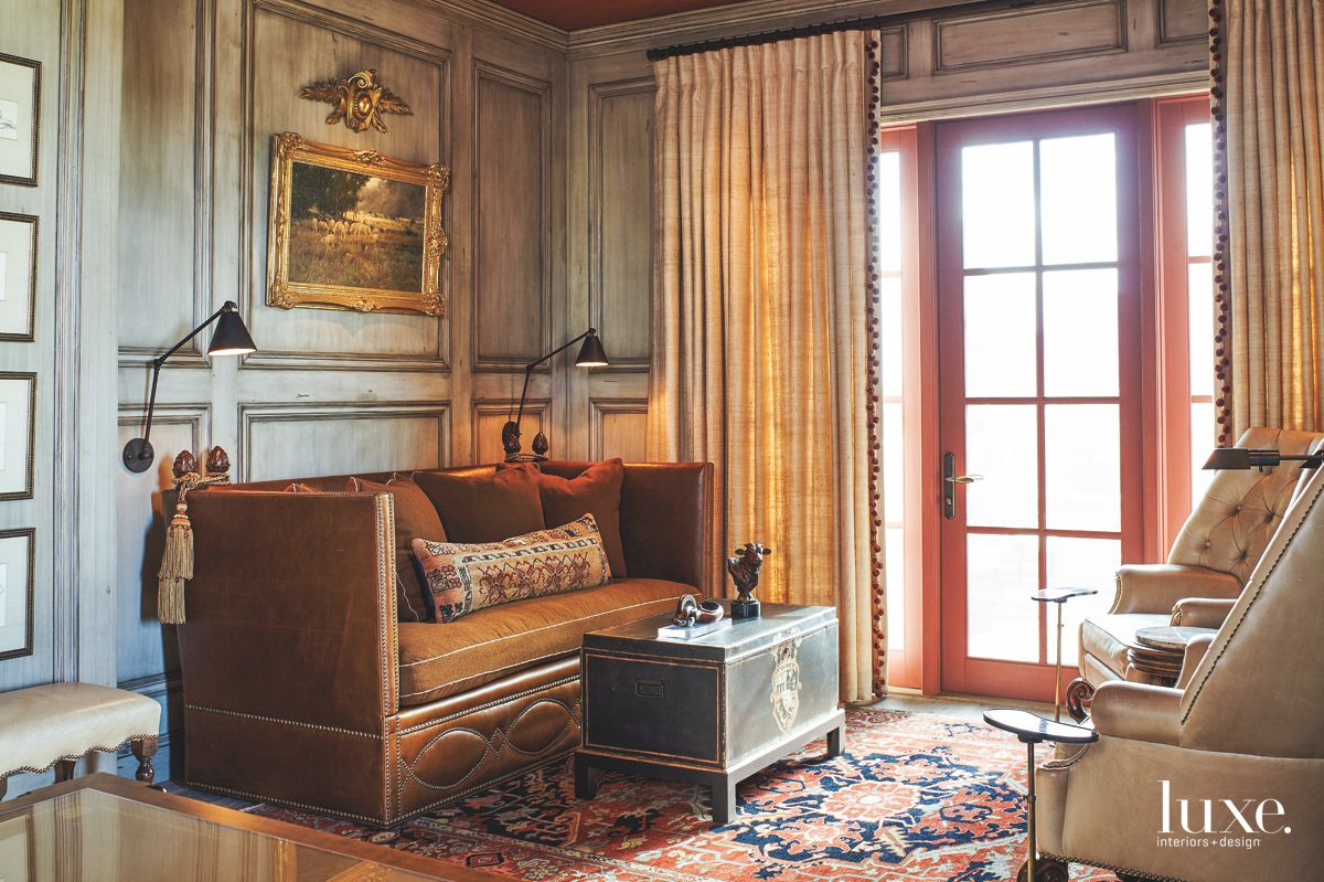 Washed Paneled Library with Leather Sofa and Antique Table